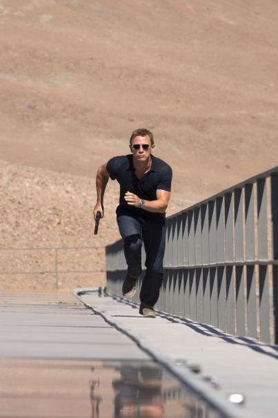 "Daniel Craig As James Bond running stairs in ""Quantum of Solace"""