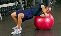 The Physio-Ball Russian Twist is a core exercise utilizing the obliques as the primary mover of the exercise. In addition, the entire musculature of the core must fire to stabilize the body in the correct position to execute the exercise.