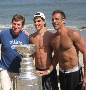 Chris Chelios, pictured at right with his son and Wayne Gretsky, is a hockey defenseman, and at 45 years old, he is now the oldest player in the league. His age doesn't mean that he can't handle the physical intensity of high-level hockey, however. He's proven numerous times that he's more than capable of keeping up with the younger athletes he teams up with, demonstrating that age does not need to be a limiting factor.