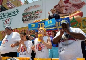 Springfield Gardens resident Eric Booker (right) will participate in this year's Nathan's Hot Dog Eating Contest on July 4. Photo Courtesy of Shea Communications