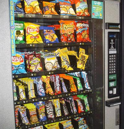 If it's a soda you crave after a sweaty basketball game on an L.A. County court, or a candy bar you hunger for while waiting at a county office, you're money's going to be no good in the vending machines.